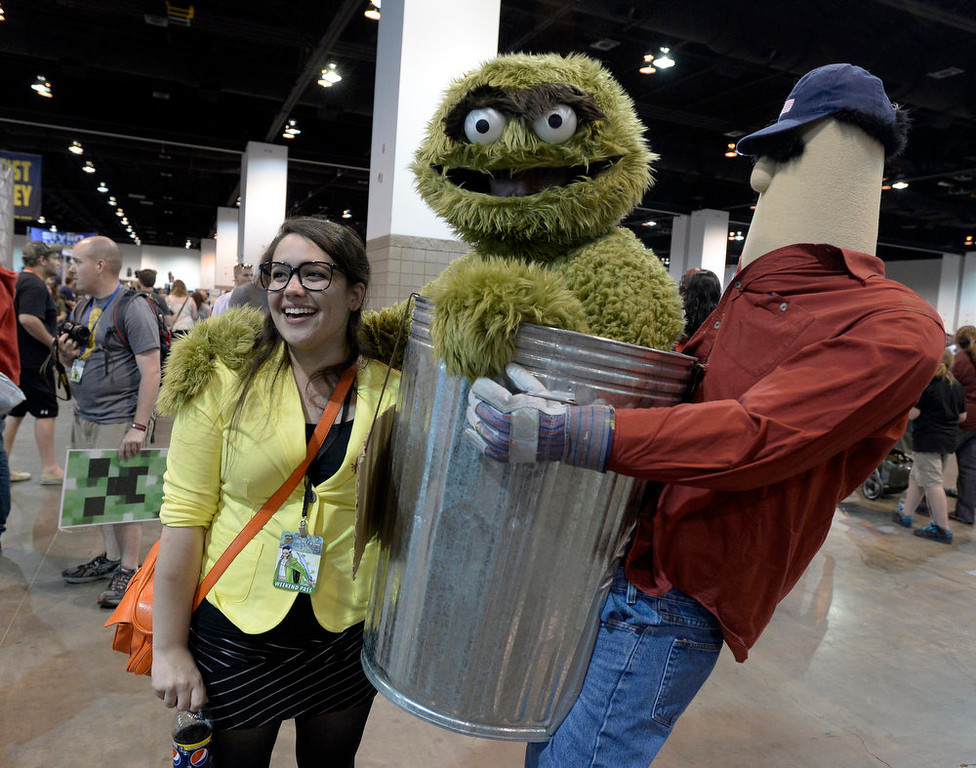 . Sadie Pepler 24-years-old pose with Oscar the Grouch as more than 45,000 flooded the convention floor for the Denver Comic Con June 2, 2013 at the Colorado Convention Center. The convention ended its three day marathon with an appearance by William Shatner. (Photo By John Leyba/The Denver Post)