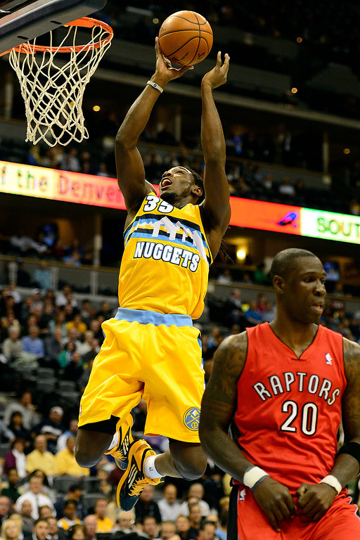 . Denver Nuggets small forward Kenneth Faried (35) scores against the Toronto Raptors during the first half at the Pepsi Center on Monday, December 3, 2012. AAron Ontiveroz, The Denver Post