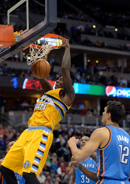 . Denver Nuggets power forward J.J. Hickson (7) gets an easy dunk past Oklahoma City Thunder center Steven Adams (12) during the first quarter December 17, 2013 at Pepsi Center. (Photo by John Leyba/The Denver Post)