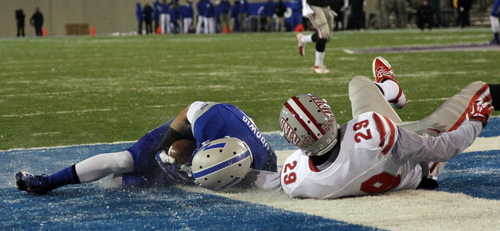 . Air Force wide receiver Alex Ludowiug, left, tumbles into the end zone after pulling in a pass for a touchdown in front of UNLV defensive back Tajh Hasson in the second quarter of an NCAA football game at Air Force Academy, Colo., on Thursday, Nov. 21, 2013. (AP Photo/David Zalubowski)