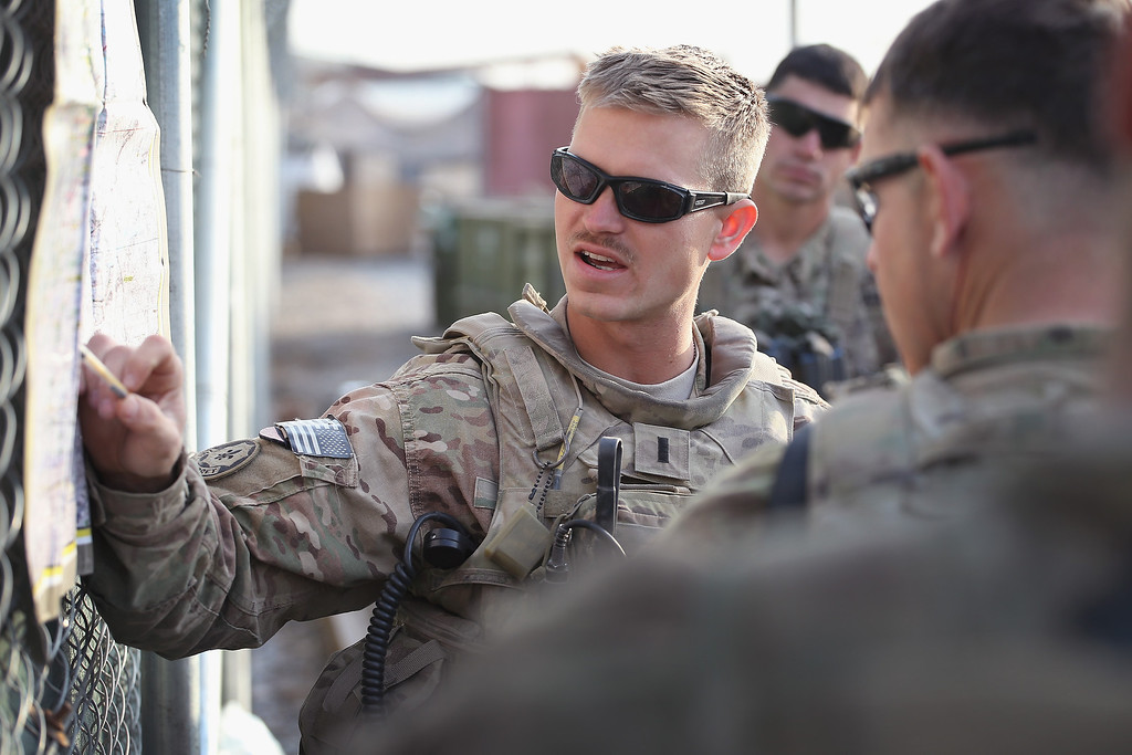 . 1LT Stephen May from St. Louis, Missouri with the U.S. Army\'s 4th squadron 2d Cavalry Regiment gives a mission brief prior to a patrol on February 25, 2014 near Kandahar, Afghanistan.   (Photo by Scott Olson/Getty Images)
