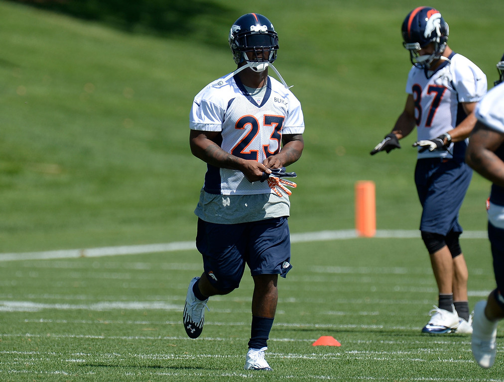 . Running back Willis McGahee (23) of the Denver Broncos head to drills mini camp June 11, 2013 at Dove Valley. (Photo By John Leyba/The Denver Post)