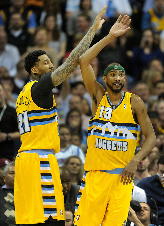 . DENVER, CO. - APRIL 6: Wilson Chandler (21) and Corey Brewer (13) of the Denver Nuggets slapped hands in the first half. The Denver Nuggets hosted the Houston Rockets at the Pepsi Center Saturday night, April 6, 2013. Photo By Karl Gehring/The Denver Post)