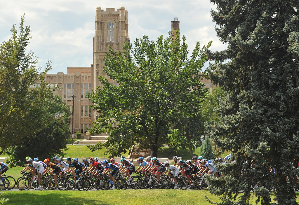 . Cyclists pass by West High School during the 75-mile 7th stage of the 2013 USA Pro Challenge race in Denver, Colorado on August 25, 2013. (Photo by Hyoung Chang/The Denver Post)
