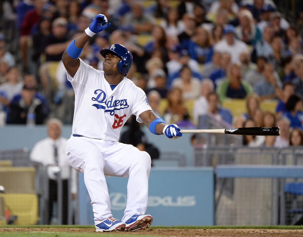 . LOS ANGELES, CA - SEPTEMBER 27:  Yasiel Puig #66 of the Los Angeles Dodgers reacts to fouling a ball off his leg during the fifth inning against the Colorado Rockies at Dodger Stadium on September 27, 2013 in Los Angeles, California.  (Photo by Harry How/Getty Images)