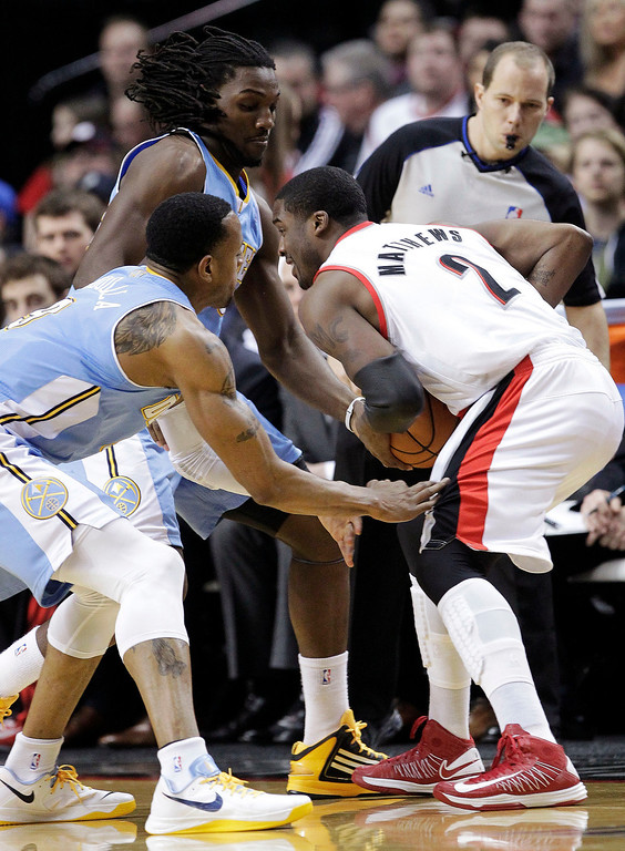 . Portland Trail Blazers guard Wesley Matthews (2) is double-teamed by Denver Nuggets\' Andre Iguodala, left, and Kenneth Faried during the first quarter of an NBA basketball game in Portland, Ore., Wednesday, Feb. 27, 2013. (AP Photo/Don Ryan)