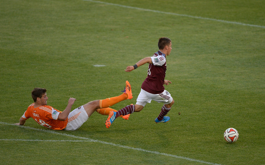 . COMMERCE CITY, CO - JUNE 01: Colorado Rapids midfielder Dillon Serna (17) gets a breakaway as he gets past Houston Dynamo defender David Horst (18) during the second half June 1, 2014 at Dick\'s Sporting Goods Park. Serna got off a short bu was deflected. (Photo by John Leyba/The Denver Post)
