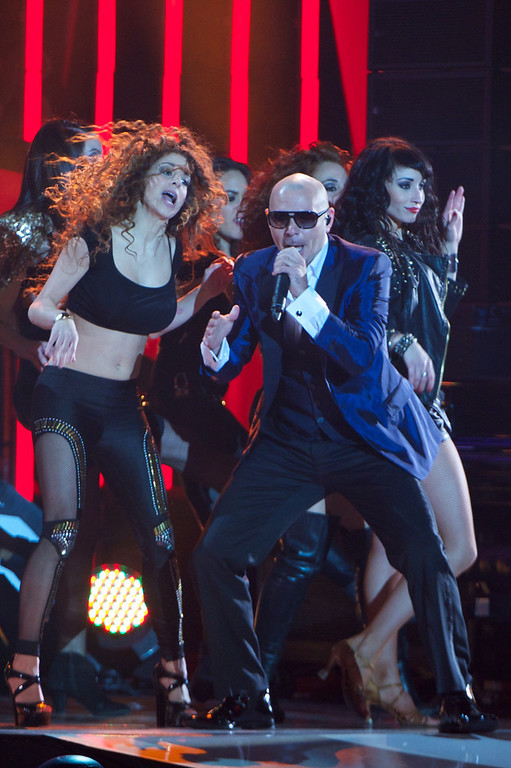 ". Pitbull performs on stage during ""40 Principales Awards\"" 2012 at Palacio de los Deportes on January 24, 2013 in Madrid, Spain.  (Photo by Carlos Alvarez/Getty Images)"