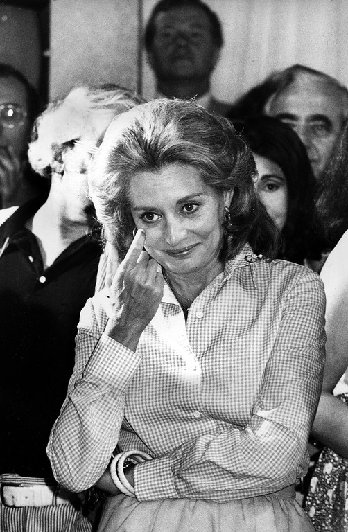 """. FILE - This June 3, 1975 file photo shows Television newswoman Barbara Walters reacting as she addresses staff members from the NBC \""""Today\"""" show during a farewell party in the studios in New York after her final live appearance on the show. Walters left to join ABC as co-host and anchorwoman of the rival networks\' evening news program. On Friday, May 16, 2014, capping a spectacular half-century run she began as the so-called \""""Today\"""" Girl, Walters will exit ABC\'s \""""The View.\"""" Behind the scenes she will remain as an executive producer of the New York-based talk show she created 17 years ago, and make ABC News appearances as events warrant and stories catch her interest. (AP Photo, File)"""