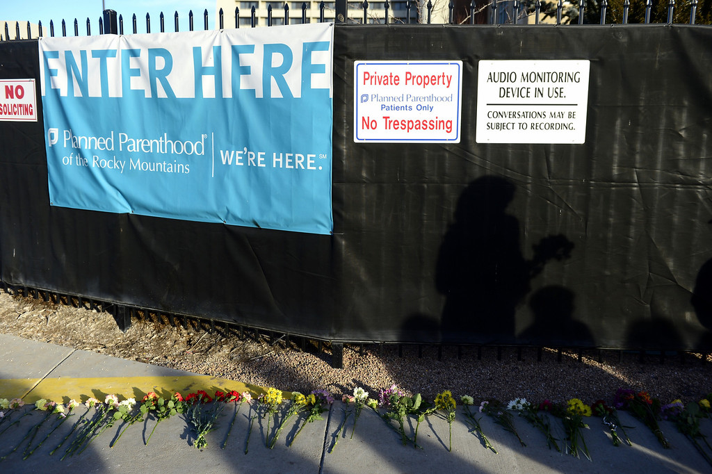 . Flowers are laid in front of a Planned Parenting facility during a protest against Roe vs. Wade at Lighthouse Women\'s Center on Sunday, January 20, 2013. AAron Ontiveroz/The Denver Post