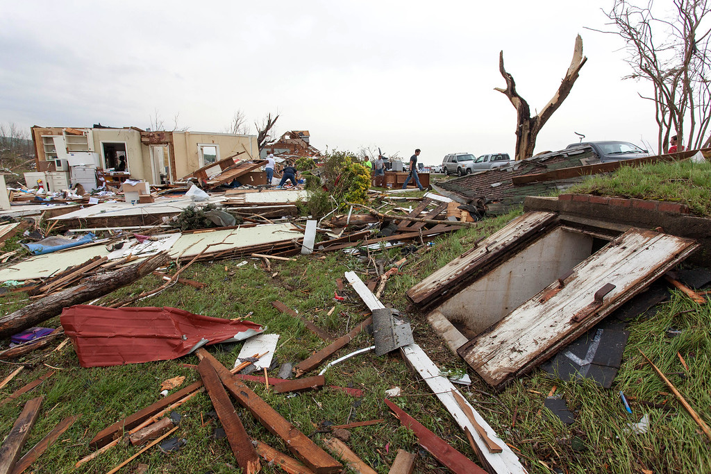 . A storm shelter, right, is where Raella Faulkner and Bobby McElroy and others took shelter in Vilonia, Ark., as a tornado struck the town on Sunday, April 27, 2014.  (AP Photo/Karen E. Segrave)