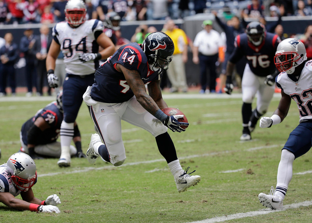 . Houston Texans\' Ben Tate (44) scores a touchdown against the New England Patriots during the first quarter of an NFL football game Sunday, Dec. 1, 2013, in Houston. (AP Photo/David J. Phillip)