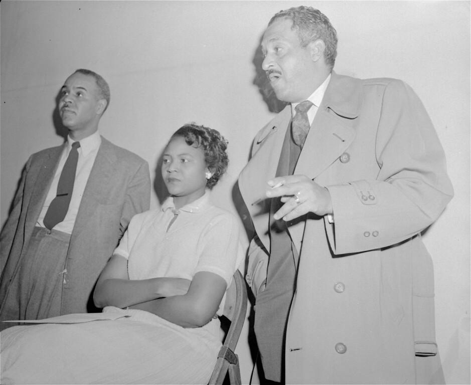 . Two leaders of the National Association for the Advancement of Colored People (NAACP) and the center of their most highly spotlighted case, pictured here on March 27, 1956.  From left to right:  Roy Wilkins, NAACP executive secretary; Autherine Lucy, would-be student at the University of Alabama; and Thurgood Marshall, head of the NAACP\'s legal staff. (AP Photo)
