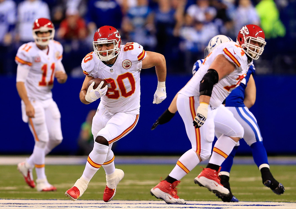 . INDIANAPOLIS, IN - JANUARY 04: Tight end Anthony Fasano #80 of the Kansas City Chiefs runs the ball against the Indianapolis Colts during a Wild Card Playoff game at Lucas Oil Stadium on January 4, 2014 in Indianapolis, Indiana.  (Photo by Rob Carr/Getty Images)