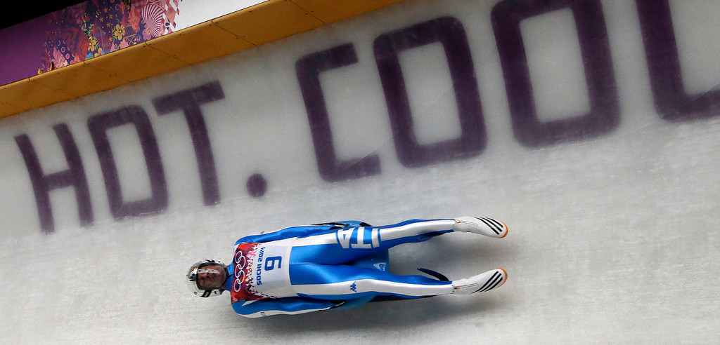 . Armin Zoeggeler of Italy takes a turn on his final run during the men\'s singles luge final at the 2014 Winter Olympics, Sunday, Feb. 9, 2014, in Krasnaya Polyana, Russia. Zoeggeler won the bronze. (AP Photo/Dita Alangkara)