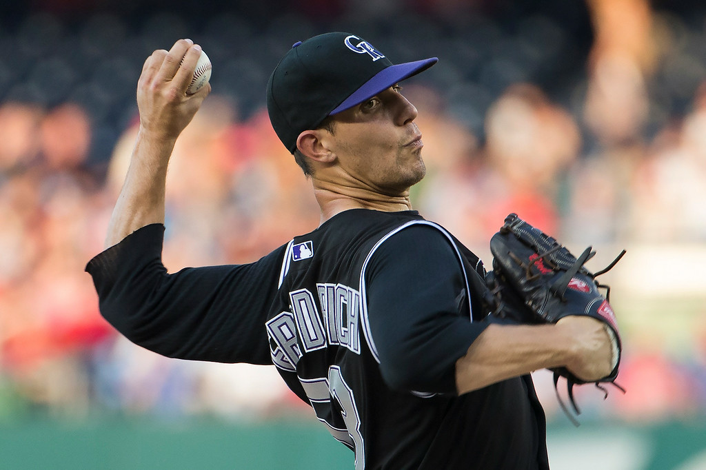 . Colorado Rockies starting pitcher Christian Friedrich delivers a pitch against the Washington Nationals during the first inning of a baseball game at Nationals Park, on Tuesday, July 1, 2014, in Washington. (AP Photo/Evan Vucci)
