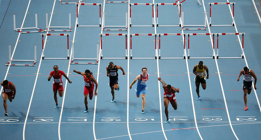 . US\'s David Oliver (3rd-R) wins the men\'s 110 meters hurdles final at the 2013 IAAF World Championships at the Luzhniki stadium in Moscow on August 12, 2013. AFP PHOTO / LOIC VENANCE/AFP/Getty Images