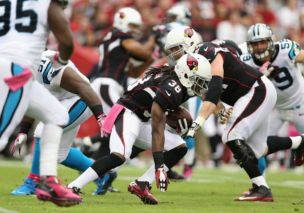 . Running back Andre Ellington #38 of the Arizona Cardinals rushes the football against the Carolina Panthers during the first quarter of the NFL game at the University of Phoenix Stadium on October 6, 2013 in Glendale, Arizona.  (Photo by Christian Petersen/Getty Images)
