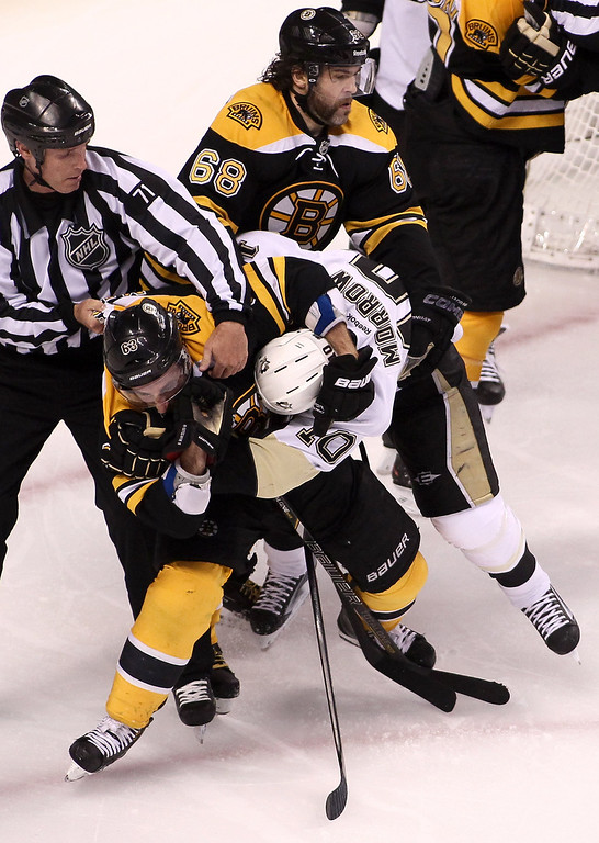 . BOSTON, MA - JUNE 07:  Brad Marchand #63 of the Boston Bruins and Brenden Morrow #10 of the Pittsburgh Penguins get tangled up in the second period in Game Four of the Eastern Conference Final during the 2013 Stanley Cup Playoffs at TD Garden on June 7, 2013 in Boston, Massachusetts.  (Photo by Alex Trautwig/Getty Images)