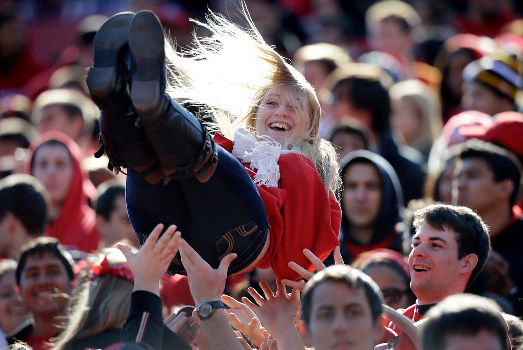. A Rutgers\' fan is tossed in the air as they celebrate a touchdown during the first half of an NCAA college football game against Houston, Saturday, Oct. 26, 2013, in Piscataway, N.J. (AP Photo/Mel Evans)