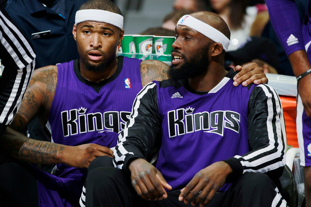. After falling into foul trouble, Sacramento Kings center DeMarcus Cousins, left, talks with forward Reggie Evans in the first half of an NBA basketball game against the Denver Nuggets in Denver, Sunday, Feb. 23, 2014. (AP Photo/David Zalubowski)