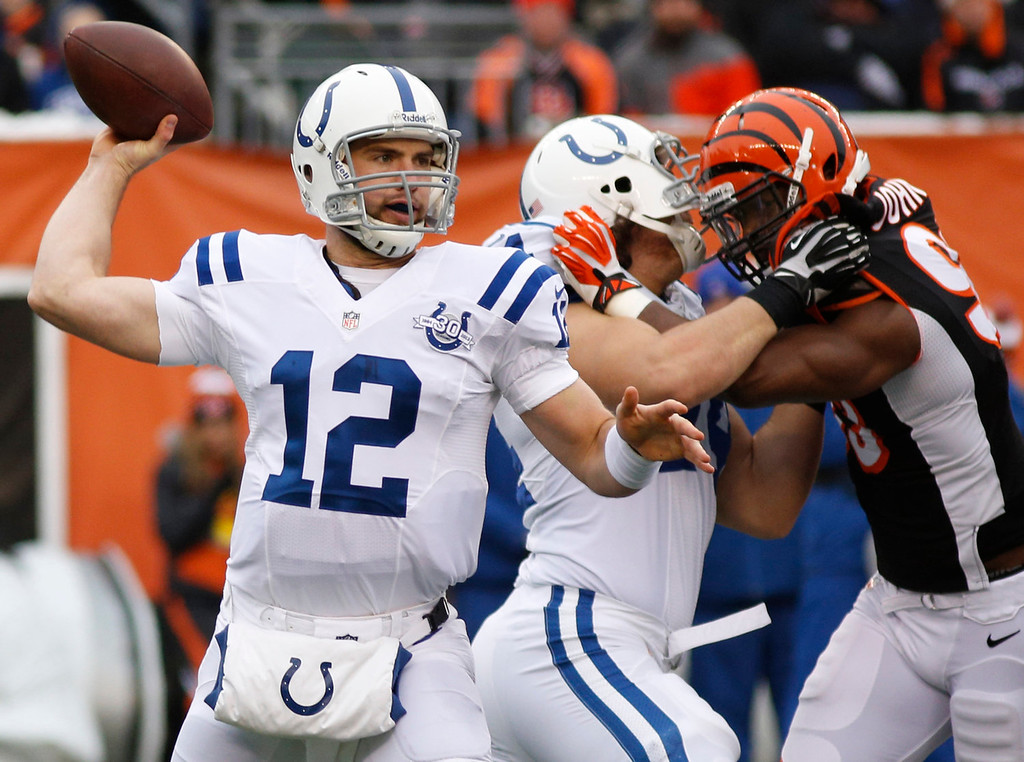 . Indianapolis Colts quarterback Andrew Luck (12) passes against the Cincinnati Bengals in the first half of an NFL football game, Sunday, Dec. 8, 2013, in Cincinnati. (AP Photo/David Kohl)