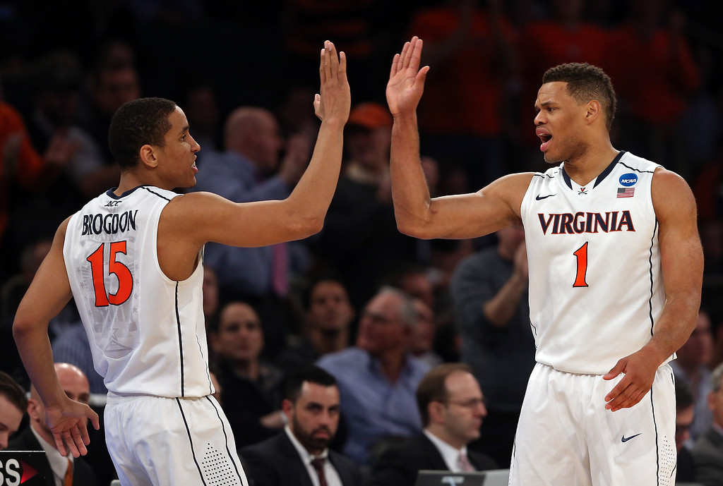 . Malcolm Brogdon #15 and Justin Anderson #1 of the Virginia Cavaliers celebrate after a play against the Michigan State Spartans during the regional semifinal of the 2014 NCAA Men\'s Basketball Tournament at Madison Square Garden on March 28, 2014 in New York City.  (Photo by Bruce Bennett/Getty Images)