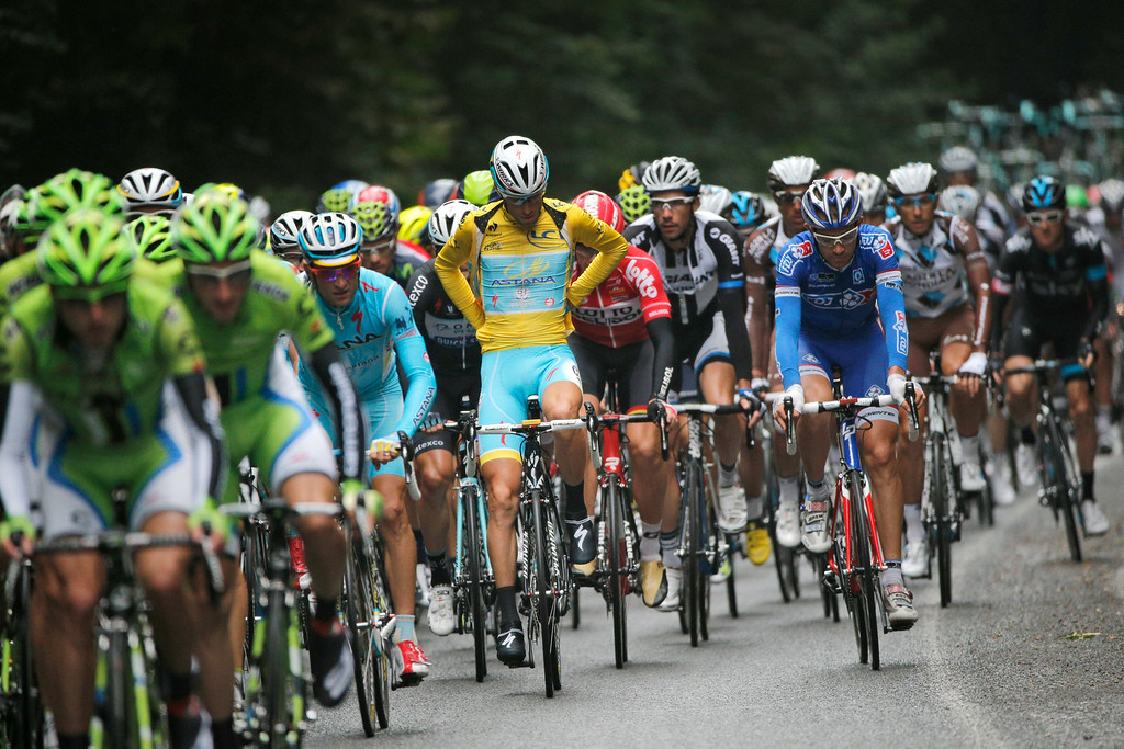 . Italy\'s Vincenzo Nibali, adjusts the overall leader\'s yellow jersey, during the seventh stage of the Tour de France cycling race over 234.5 kilometers (145.7 miles) with start in Epernay and finish in Nancy, France, Friday, July 11, 2014. (AP Photo/Christophe Ena)