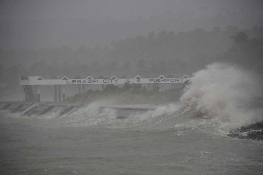 . Huge waves brought about by powerful typhoon Haiyan hit the shoreline in Legazpi city, Albay province Friday, Nov. 8, 2013 about 520 kilometers ( 325 miles) south of Manila, Philippines. (AP Photo/Nelson Salting)