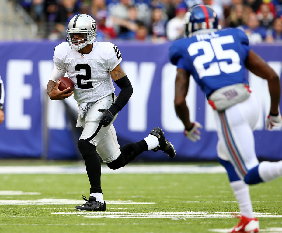 . Terrelle Pryor #2 of the Oakland Raiders carries the ball as  Will Hill #25 of the New York Giants defends in the first quarter at MetLife Stadium on November 10, 2013 in East Rutherford, New Jersey.  (Photo by Elsa/Getty Images)