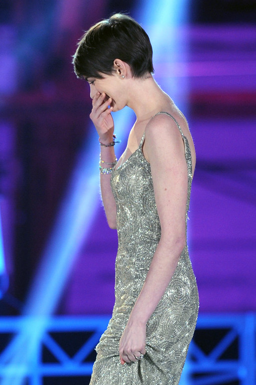 ". Actress Anne Hathaway accepts the Best Supporting Actress Award for ""Les Miserables\"" onstage at the 18th Annual Critics\' Choice Movie Awards held at Barker Hangar on January 10, 2013 in Santa Monica, California.  (Photo by Kevin Winter/Getty Images)"