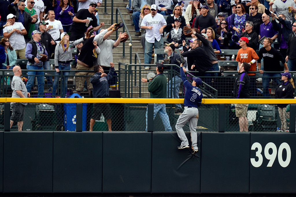 . DENVER, CO - MAY 5: Kelly Johnson (2) of the Tampa Bay Rays climbs the fence as a home run hit by Nolan Arenado (28) of the Colorado Rockies clears the fence during the Rockies\' 8-3 loss.   (Photo by AAron Ontiveroz/The Denver Post)