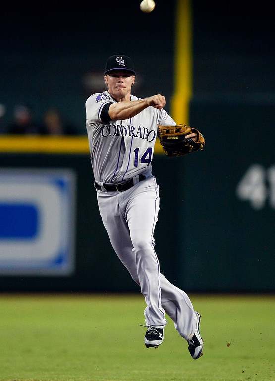 . Colorado Rockies second baseman Josh Rutledge makes an off-balance throw for the out in the first inning during a baseball game against the Arizona Diamondbacks, Sunday, Sept. 15, 2013, in Phoenix. (AP Photo/Rick Scuteri)