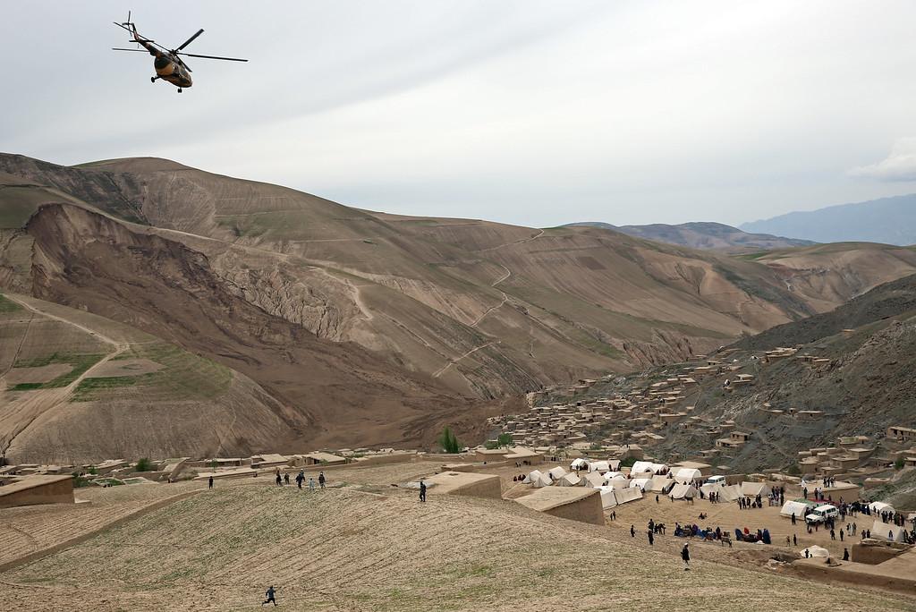 . In this Sunday, May 4, 2014 photo, Survivors walk near the site of Friday\'s landslide that buried Abi-Barik village in Badakhshan province, northeastern Afghanistan. (AP Photo/Massoud Hossaini)