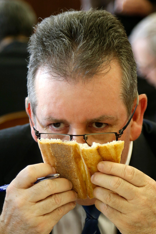 . Jury member Pascal Barillon, winner of the 2011 Paris Best Baguette award, sniffs a baguette, French bread, in competition for the \'Grand Prix de la Baguette de la Ville de Paris\' (Best Baguette of Paris 2013) annual prize at the Chambre Professionnelle des Artisans Boulangers Patissiers in Paris April 25, 2013. The baguette is a French cultural symbol par excellence and the competition saw 203 Parisian bakers who compete for recognition as finest purveyor of one of France\'s most iconic staples. The baguettes are registered, given anonymous white wrappings and an identification number. They are then carefully weighed and measured to ensure they do not violate the contest\'s strict rules. 52 entries were withdrawn for failing to measure between 55-70cm long or not matching the acceptable weight of between 250-300g. Every year, the winner earns the privilege of baking bread for the French President.   REUTERS/Charles Platiau