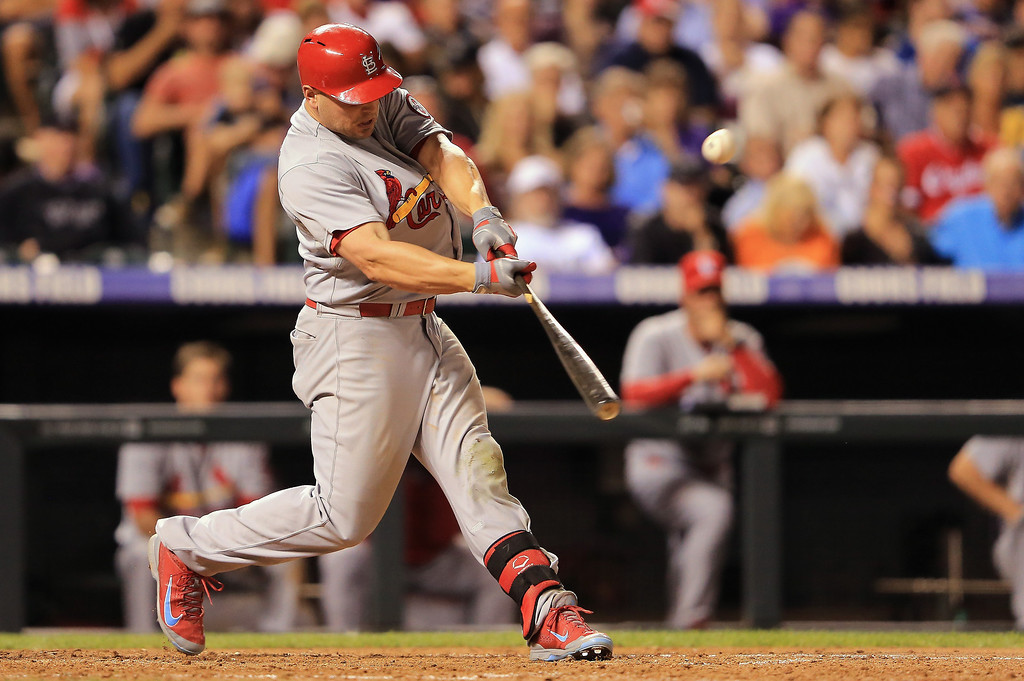 . Matt Holliday #7 of the St. Louis Cardinals hits a two run homerun off of Rob Scahill #62 of the Colorado Rockies to give the Cards a 10-0 lead in the fifth inning at Coors Field on September 17, 2013 in Denver, Colorado.  (Photo by Doug Pensinger/Getty Images)