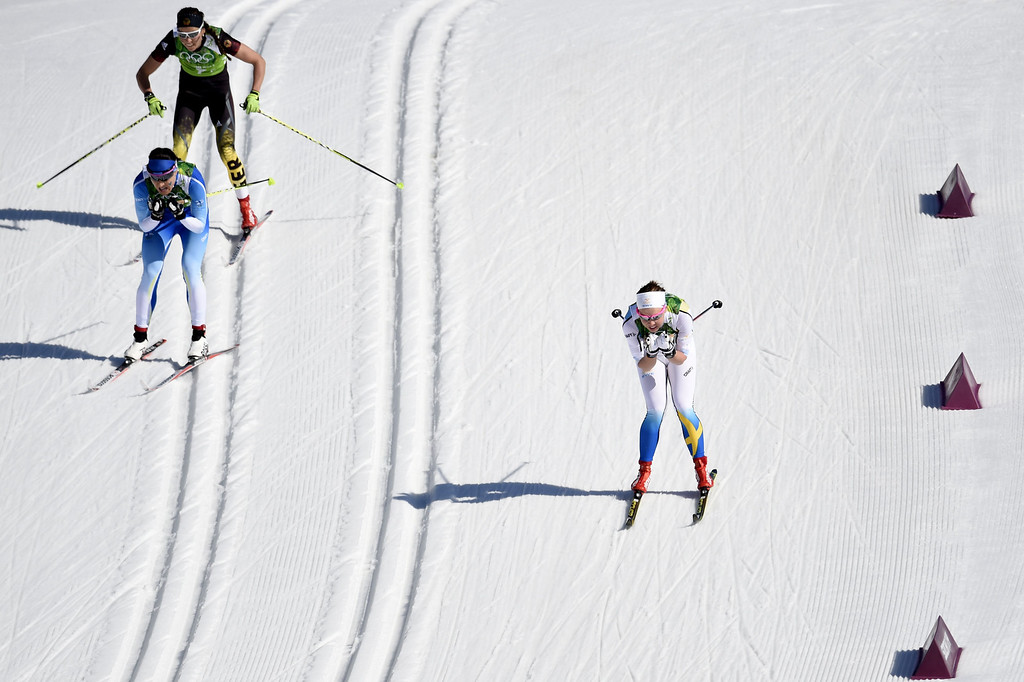 . Germany\'s Stefanie Boehler (top L), Finland\'s Aino-Kaisa Saarinen (L) and Sweden\'s Emma Wiken compete in the Women\'s Cross-Country Skiing 4x5km Relay at the Laura Cross-Country Ski and Biathlon Center during the Sochi Winter Olympics on February 15, 2014, in Rosa Khutor, near Sochi.   ODD ANDERSEN/AFP/Getty Images