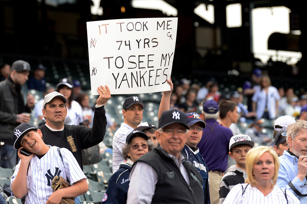 . DENVER, CO. - MAY 07: New York Yankees fan holds up a sign during the Colorado Rockies New York Yankees batting practice May 7, 2013 at Coors Field. (Photo By John Leyba/The Denver Post)