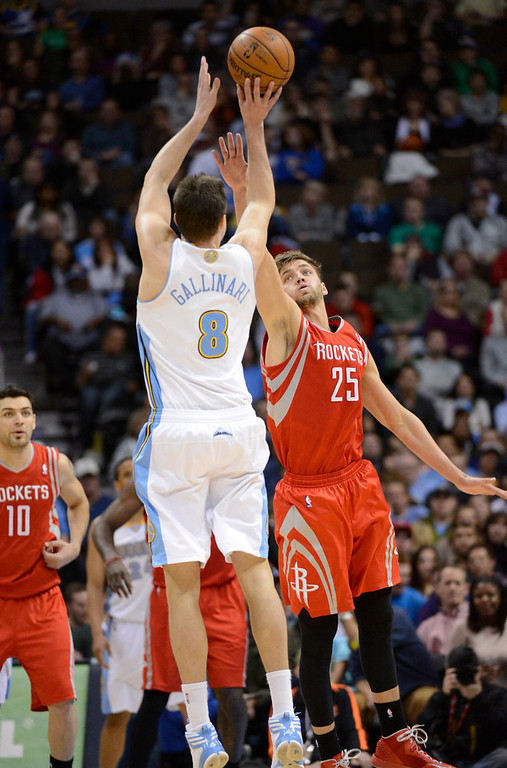 . DENVER, CO. - JANUARY 30: Denver Nuggets small forward Danilo Gallinari (8) takes a three point shot over Houston Rockets small forward Chandler Parsons (25) during the fourth quarter January 30, 2013 at Pepsi Center. Danilo Gallinari made the shot and led in scoring with 27 points. The Denver Nuggets take on the Houston Rockets in NBA action. (Photo By John Leyba/The Denver Post)