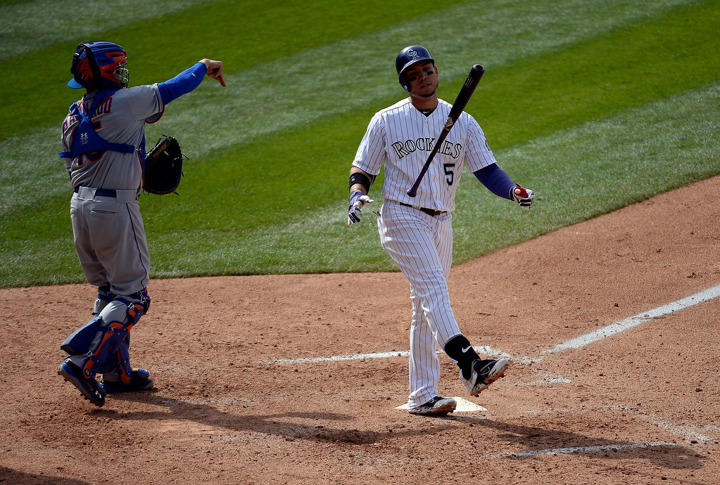 . Colorado Rockies left fielder Carlos Gonzalez (5) flips his bat after striking out in the 6th inning against the York Mets May 4, 2014 at Coors Field. (Photo by John Leyba/The Denver Post)