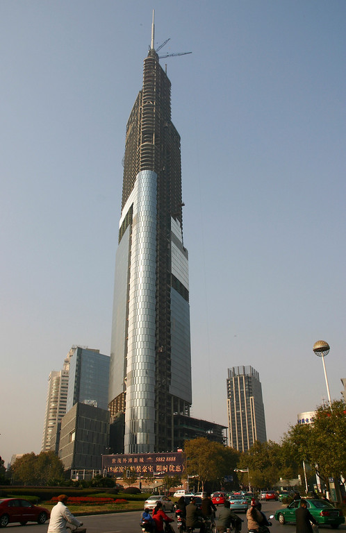 . In this Saturday, Nov. 30, 2008 photo, motorists drive past the under construction Zifeng Tower in Nanjing in east China\'s Jiangsu province.  (AP Photo, File) CHINA OUT