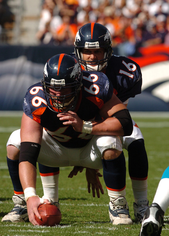 . Denver Bronco Center #66 Tom Nalen gets ready to  snap the ball during the game between the Carolina Panthers and the Denver Broncos at Invesco Field at Mile High in Denver on Sunday Oct. 10th, 2004.    DENVER POST PHOTO BY STEVE DYKES