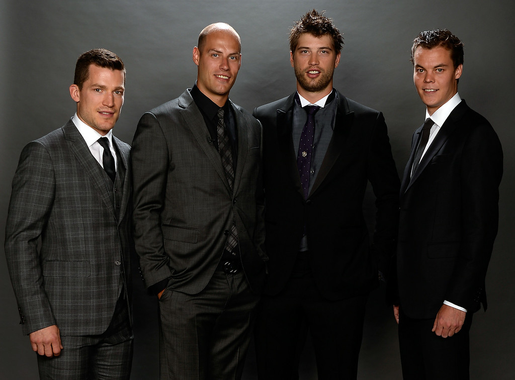 . Andrew Ference of the Edmonton Oilers, Ryan Getzlaf of the Anaheim Ducks, Brent Burns of the San Jose Sharks, and Tuukka Rask of the Boston Bruins pose for a portrait during the 2014 NHL Awards at Encore Las Vegas on June 24, 2014 in Las Vegas, Nevada.  (Photo by Harry How/Getty Images)