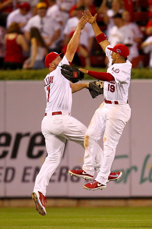 . ST LOUIS, MO - OCTOBER 03:  Matt Holliday #7 and Jon Jay #19 of the St. Louis Cardinals celebrate the Cardinals 9-1 victory against the Pittsburgh Pirates during Game One of the National League Division Series at Busch Stadium on October 3, 2013 in St Louis, Missouri.  (Photo by Dilip Vishwanat/Getty Images)