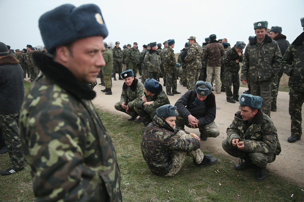 . Unarmed Ukrainian troops rest on the Belbek airfield after they confronted soldiers under Russian command occupying the base in Crimea on March 4, 2014 in Lubimovka, Ukraine.   (Photo by Sean Gallup/Getty Images)