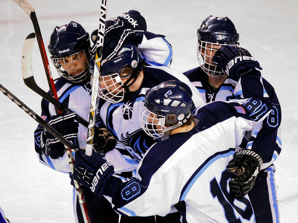 . DENVER, CO. - FEBRUARY 28: The Mustangs celebrated with forward Greg Dyba (7) after his second period goal Thursday night. Ralston Valley High School took on Resurrection Christian Thursday night, February 28, 2013 in a semifinal match in the Colorado State Ice Hockey Championships at Magness Arena in Denver. (Photo By Karl Gehring/The Denver Post)