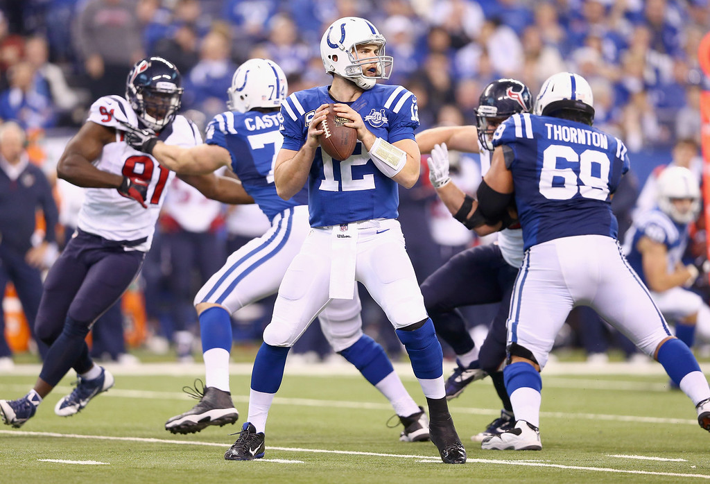 . Andrew Luck #12 of the Indianapolis Colts throws a pass during the NFL game against the Houston Texans at Lucas Oil Stadium on December 15, 2013 in Indianapolis, Indiana.  (Photo by Andy Lyons/Getty Images)