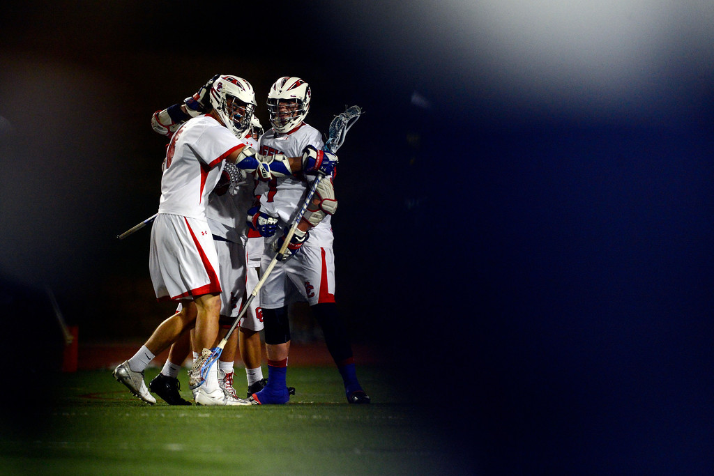 . Cherry Creek players celebrate a late goal during Cherry Creek\'s 7-6 win.  (Photo by AAron Ontiveroz/The Denver Post)