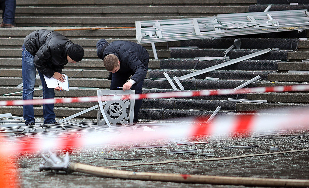 . Russian police investigators collect evidence following a suicide attack at a train station in the Volga River city of Volgograd on Sunday, December 29, 2013.    AFP/Getty Images