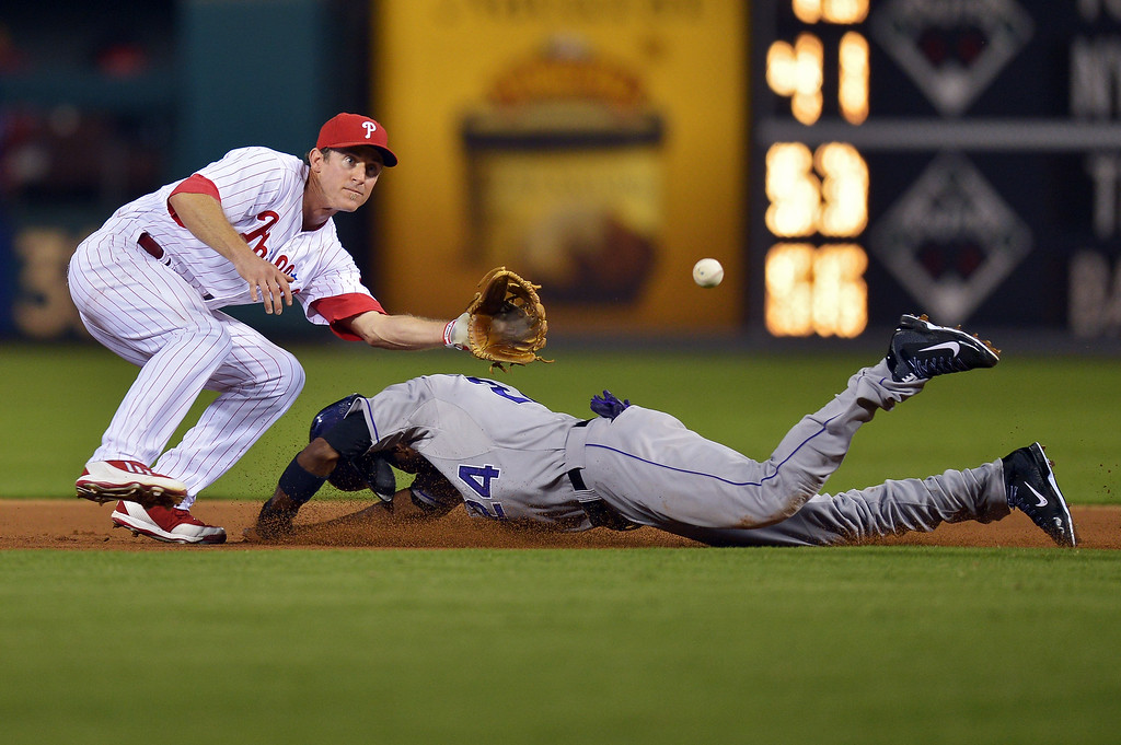 . Chase Utley #26 of the Philadelphia Phillies waits for the ball to tag out Dexter Fowler #24 of the Colorado Rockies on a steal in the seventh inning at Citizens Bank Park on August 20, 2013 in Philadelphia, Pennsylvania. The Rockies won 5-3. (Photo by Drew Hallowell/Getty Images)